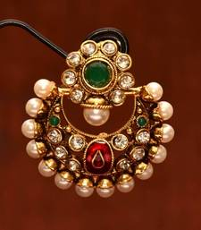 Anvi's polki chand bali with emerald, pearls and enamel