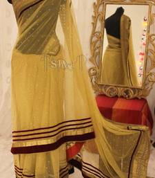 Buy Gold dusted with Stones net-saree online