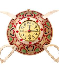 Buy Rajasthani Real Brass Sword Armour Wall Clock wall-clock online