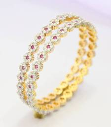 Buy BEAUTIFUL CZ STONE STUDDED 7 STONE FLOWER BANGLE Bracelet online