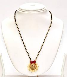 Buy Anvi's black beads chain with uncut stones centered with ruby mangalsutra online