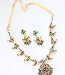 Buy BEAUTIFUL RED GREEN N WHITE POLKI STONE STUDDED NECKLACE SET Necklace online