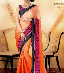 Buy Glamorous peach embroidered saree wedding-saree online