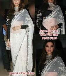 Buy Deepika padukone aarakshan promo white designer net saree deepika-padukone-saree online