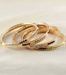Buy designer gold platted bangles size-2.6,2.10 bangles-and-bracelet online