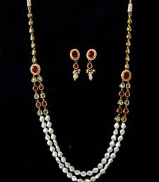 Buy KUNDAN STONES SIDE PIECE PEARLS NECKLACE SET Necklace online