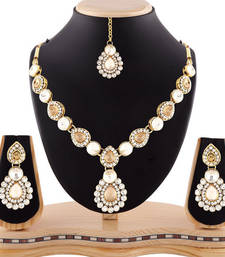 Buy Gracefull design austrian stone gold finishing necklace set with maang tikka eid-jewellery online