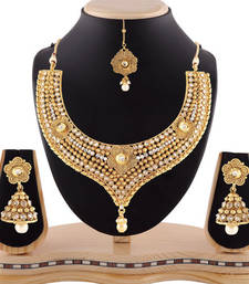 Buy Gracefull design pearl drop gold finishing necklace set with maang tikka necklace-set online