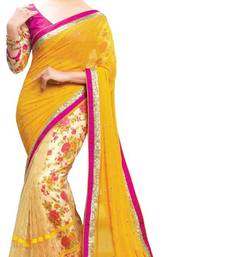Buy Yellow embroidered Net saree With Blouse party-wear-saree online