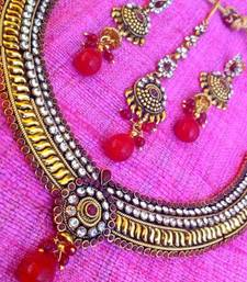Buy Dazzling maroon stone and polki work with ethnic golden base necklace set j45m  Necklace online