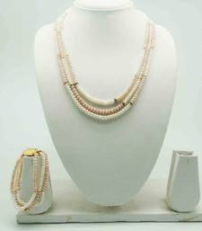 Buy Beautiful Designer Pearl Set of Necklace, Earrings and Bracelet necklace-set online
