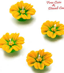Buy Yellow flower wax candle diyas- set of 4 candle online