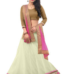 Buy Auspicious Cream Colored Border Worked Net Satin Lehenga Choli shimmer-saree online