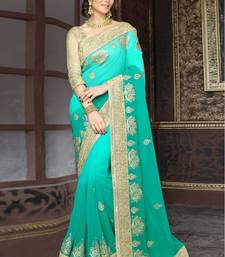 Buy turquoise and sea green embroidered georgette saree with blouse eid-saree online