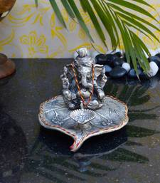 Buy eCraftIndia Lord Ganesha with Diya on Leaf sculpture online