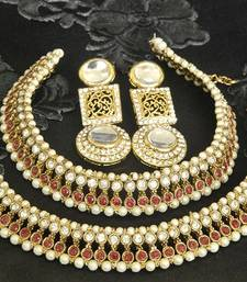 Gold Plated Handcrafted White colour Earrings & Maroon colour Anklets with Pearl shop online