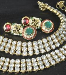 Gold Plated Handcrafted Maroon, Green Earrings & White colour Jodha Akbar Anklets shop online