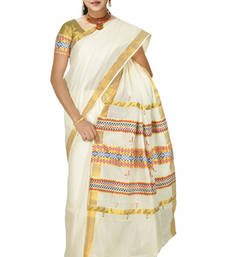 Buy cream colour sarees customised with brocade horizontal multicolour work border. south-indian-saree online