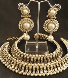 Buy Kundan Pearl Anklets & Pearl Earrings jewellery-combo online