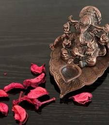 Buy Metal Lord Ganesha with Diya on Leaf new-year-gift online