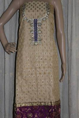 Golden and peach embroidered dress material