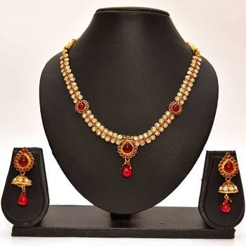 Anvi's stylized white stone necklace and earrings studded with white stones and rubies