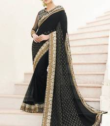 Buy Black Viscose Net Saree with Raw Silk Embroidered Blouse Piece viscose-saree online