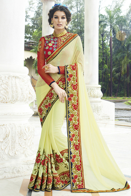 Yellow embroidered Georgette saree with blousre