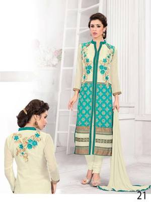 Cream and sea green embroidered georgette semi stitched salwar with dupatta