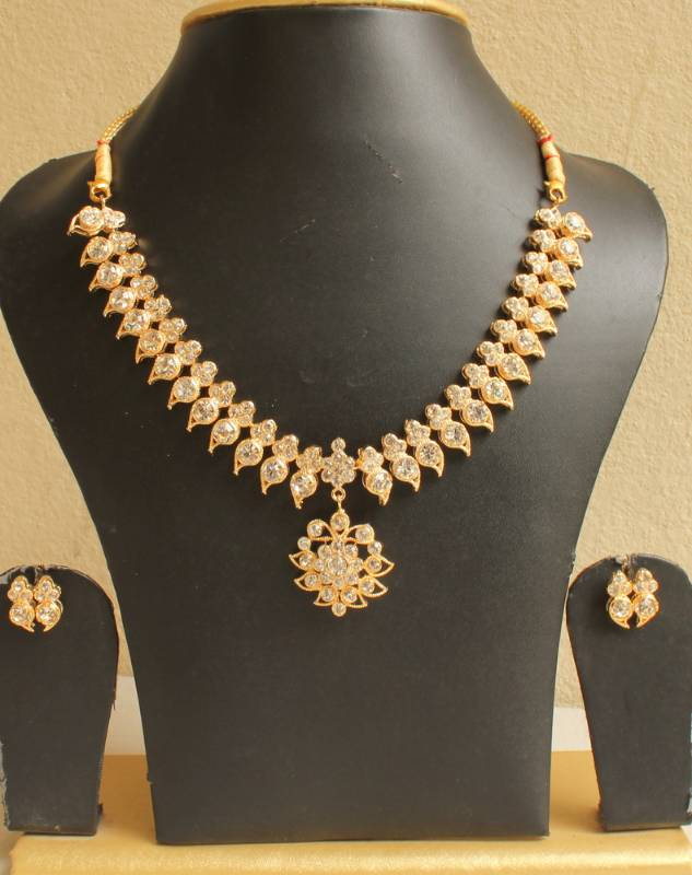 Buy GORGEOUS GOLD PLATED WHITE MANGO SOUTH INDIAN STYLE NECKLACE SET