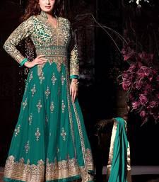 Buy Green net embroidered semi stitched salwar with dupatta wedding-salwar-kameez online