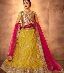 Buy Yellow net embroidered  lehenga choli net-lehenga online