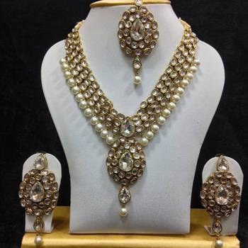 Dazzling Kundan Set in White with Pearls