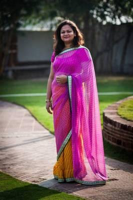 Yellow leheriya and pink georgette half and half saree