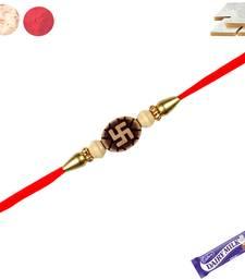 Buy Auspicious swastik rakhi with beads with kaju katali rakhi-with-sweet online