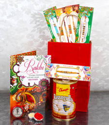 Buy Rakhi gift bag of five rakhis and rasgulla with laxmi ganesha coin fashion-deal online