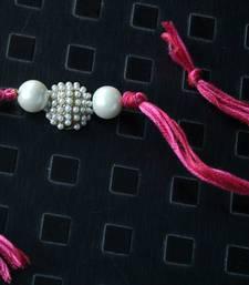 Buy Pink Jadau Pearl Rakhi pearl-rakhi-design online