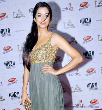 Madhura Naik in Grey gown with sequins and stones on neck