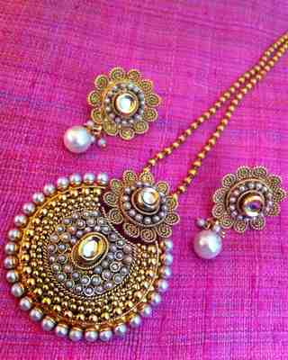 Buy dazzling kundan pearl polki antique golden flower pendant set dazzling kundan pearl polki antique golden flower pendant set s102w aloadofball Images