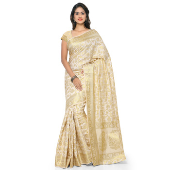 cream woven tussar silk saree With Blouse