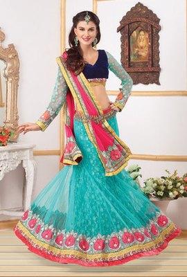 This a Turquoise Colour Net Lehenga Choli with Net Dupatta