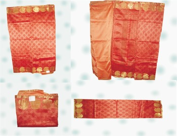 Supernet Saree in Rust Orange combo with tribal print and paisley gold border