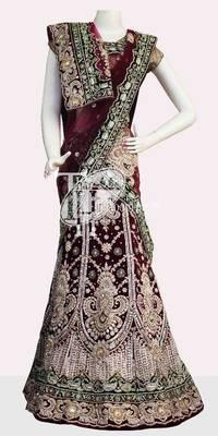 Wonderful wine heavy diamond rasham design work bridal lehenga
