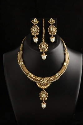 Ethnic gold plates party wear necklace set with maang tikka