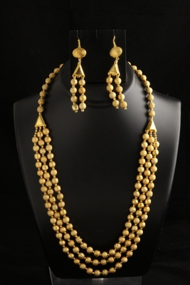 Three layered golden beads necklace set with earrings