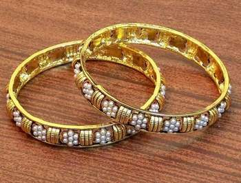 Traditional and ethnic pearl gold plated bangles