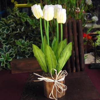 White Artificial Tulips on a Round Wooden Vase