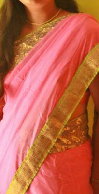 Baby pink georgette saree with sprinkled sequins border
