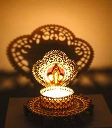 Buy Shadow diya tealight candle holder of removable designary ganesha face diya online