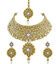 Buy Golden Beige Polki Stones Necklace Set with Maang Tika Jewellery for Women - Orniza necklace-set online